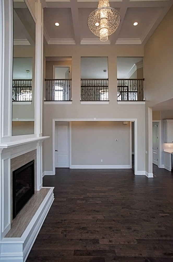 2 Story Living Room With Mirrored Fireplace
